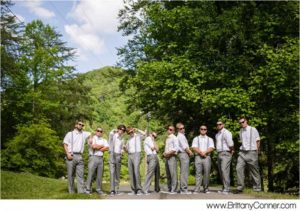 groomsman party in gray pants and white shirts